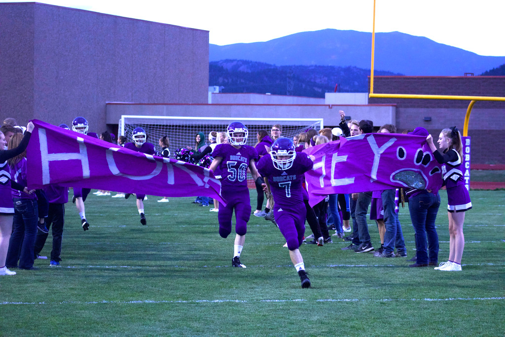 . Estes Park High School football sprints through the spirit line en route to a victory over Front Range Christian.  Photos by Nic Wackerly