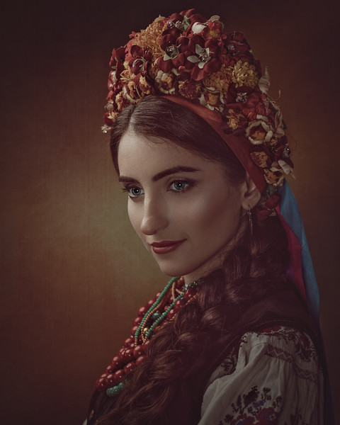 Ethno Beauty. Beautiful young woman in traditional ukrainian dress and crown
