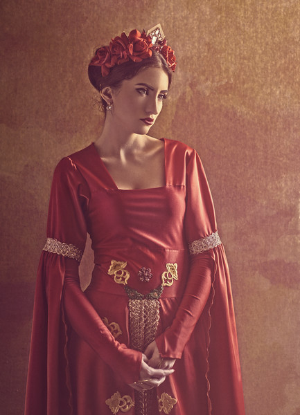 Honor and pride. Female portrait with medieval dress and crown