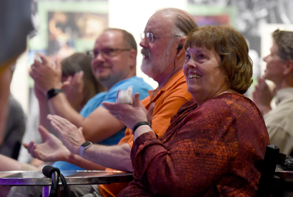 . Barbara Coles, right, Steve Coles and Steve Weaver applaud the musicians during a Boulder In-the-Round Songwriter Showcase on Wednesday at the eTown Hall in Boulder. Jeremy Papasso/ Staff Photographer 06/08/2018