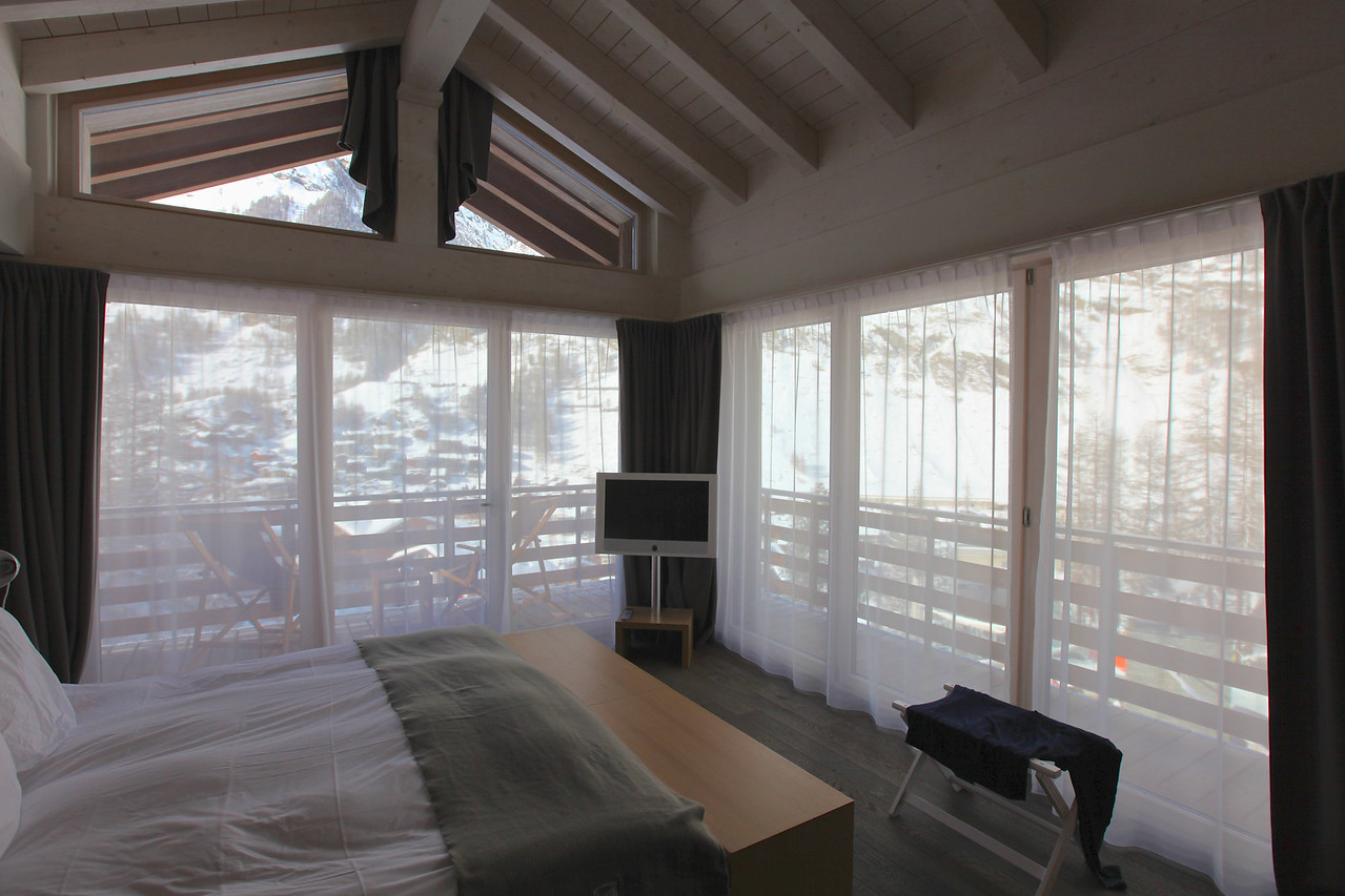 "The bedroom area has great views with glass ""walls"" on two sides.  There's also a large sitting area on each deck."