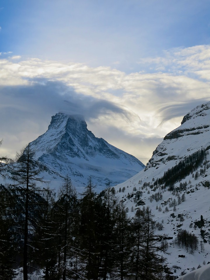 And as the sun sets, the clouds roll in obscuring the top of the Matterhorn.