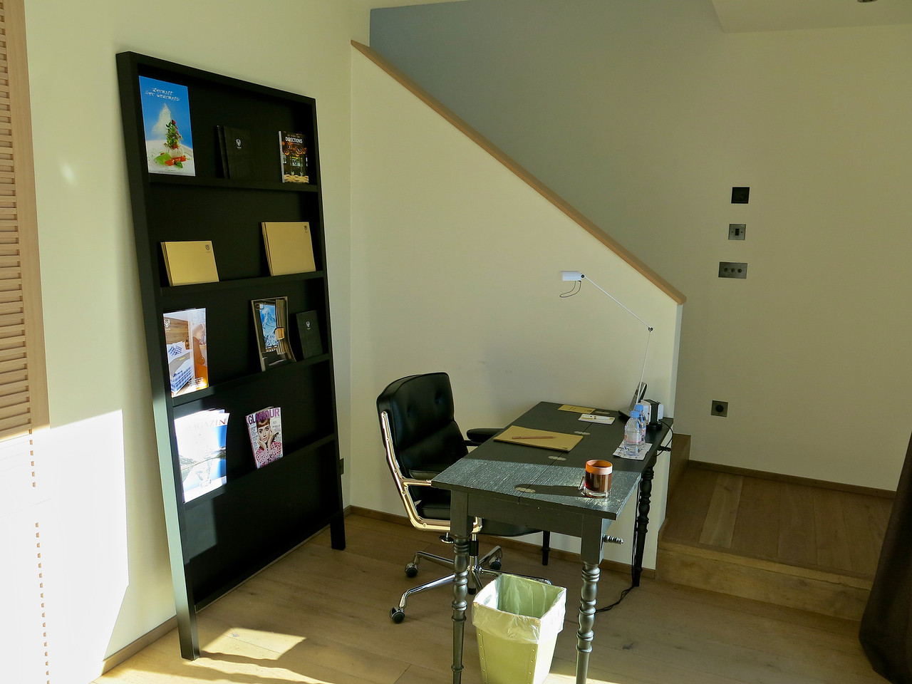 Around the corner from the kitchen is a small office area with desk and chair.