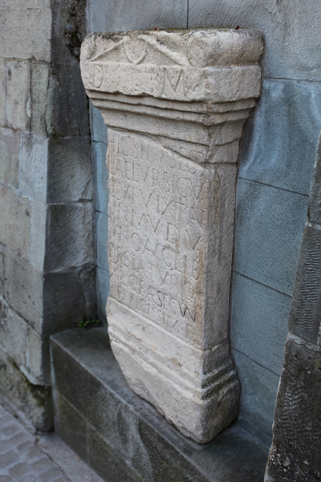 Artifacts dating back to 1500 BC have been found in the square.  In the wall surrounding the square is a replica of a tombstone from the grave of Lucius Aelius Urbicus' a one year old from (200 AD).  The original is located in the Swiss Museum in Zurich and was discovered in 1747.