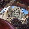 Reflection through a new outdoor exhibit being assembled outside of the Guggenheim