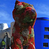Puppy is constructred from stainless steel, soil and flowering plants.