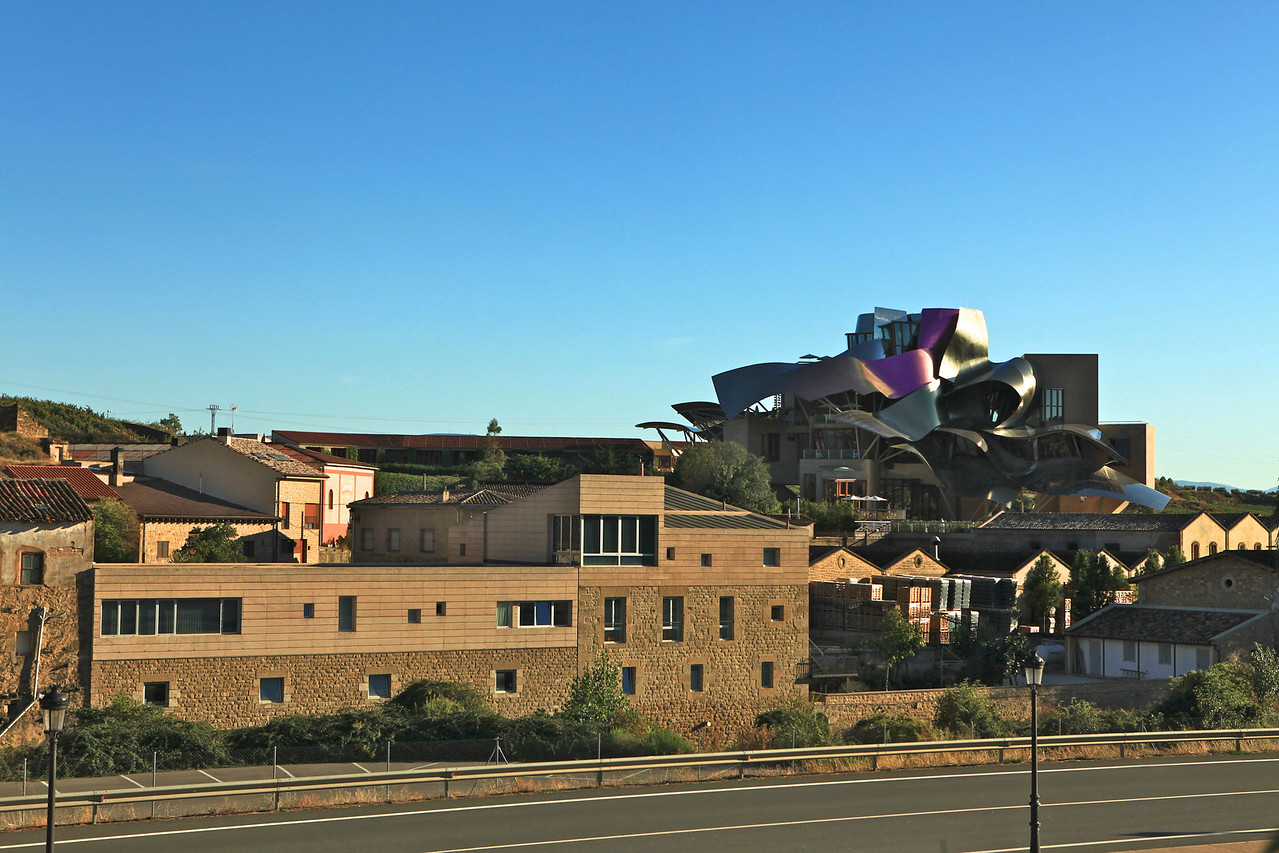 """The Frank Gehry designed Marques de Riscal hotel was built in 2006 in Elciego.  The building also houses the winery.  Not all rooms are inside the main building.  Many are located in a """"plain"""" building behind the hotel connected by an elevated walkway."""