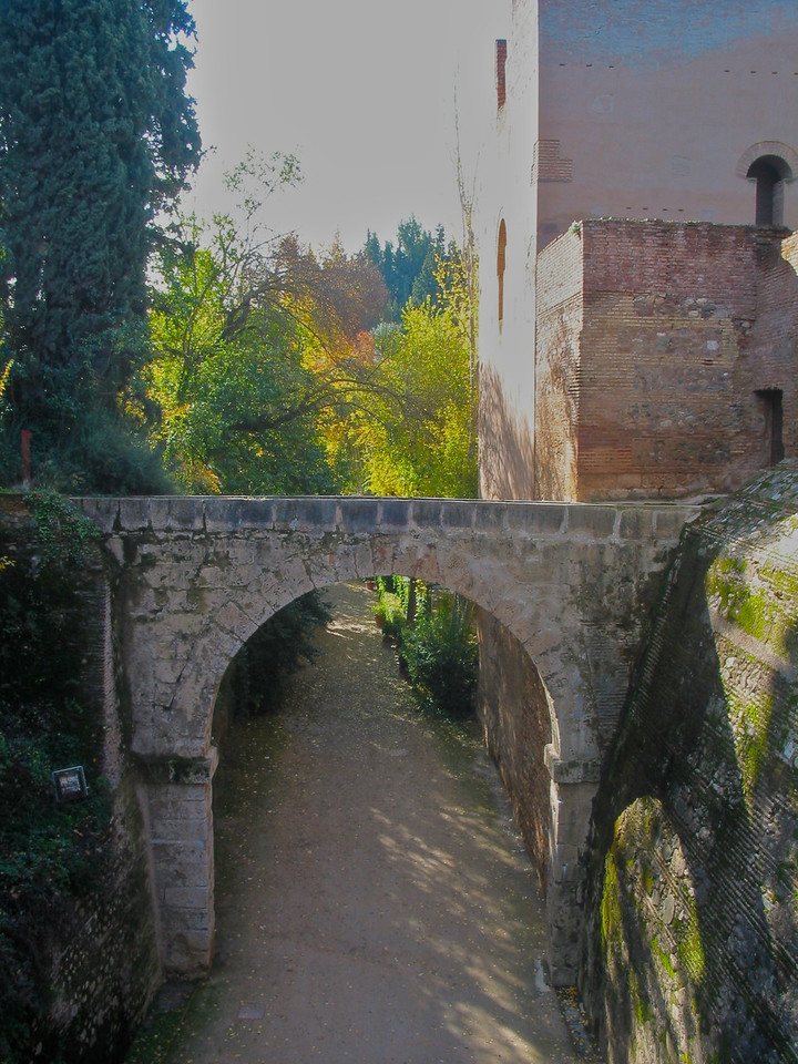 """Alhambra was added onto by the different Muslim rulers who lived in the complex. Each new section that was added followed the consistent theme of """"paradise on earth."""" Column arcades, fountains with running water, and reflecting pools were used to make add to the aesthetic and functional complexity. The exterior was left plain and austere."""