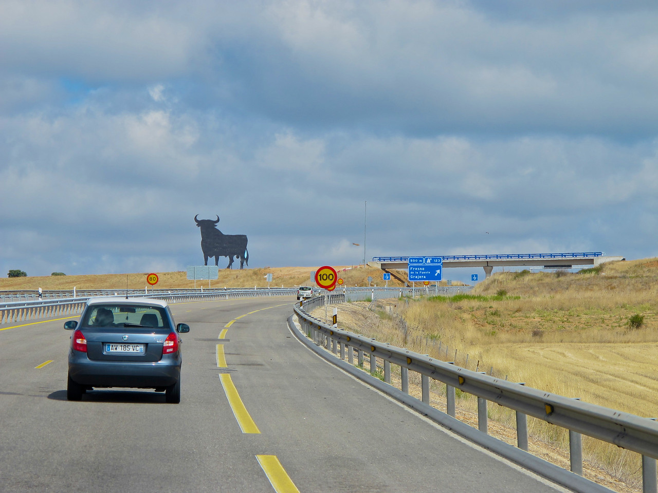"""Along many highways in Spain, you'll see the familiar bull.  Many people think these are to promote Spain tourism, however, they were actually once billboards for a Spanish-Portuguese wine company, called Grupo Osborne.  Several years ago, Spain banned billboards from highways.  There was such a protest from the public that the """"bulls"""" would be taken down, that the government relented and let them stay as long as all advertising was removed."""