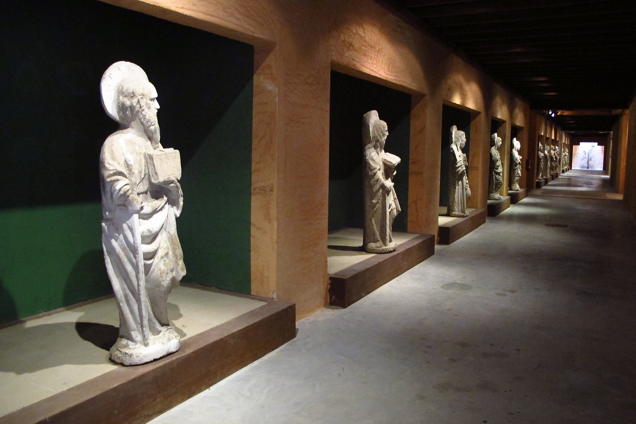 As we head through the cellar, there are statues of each of the apostles along the way.