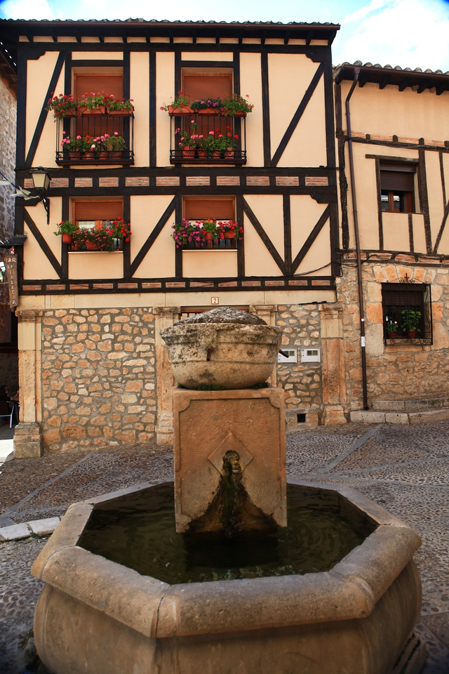 """This """"water fountain"""" in the upper part of the square has been a water source since the 1500s.  It was renovated in the 1960s with some parts of the original fountain."""