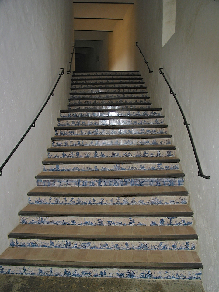 Stairs to the spectator stands have locally made tiles depicting scenes of the matador and bullfighting.