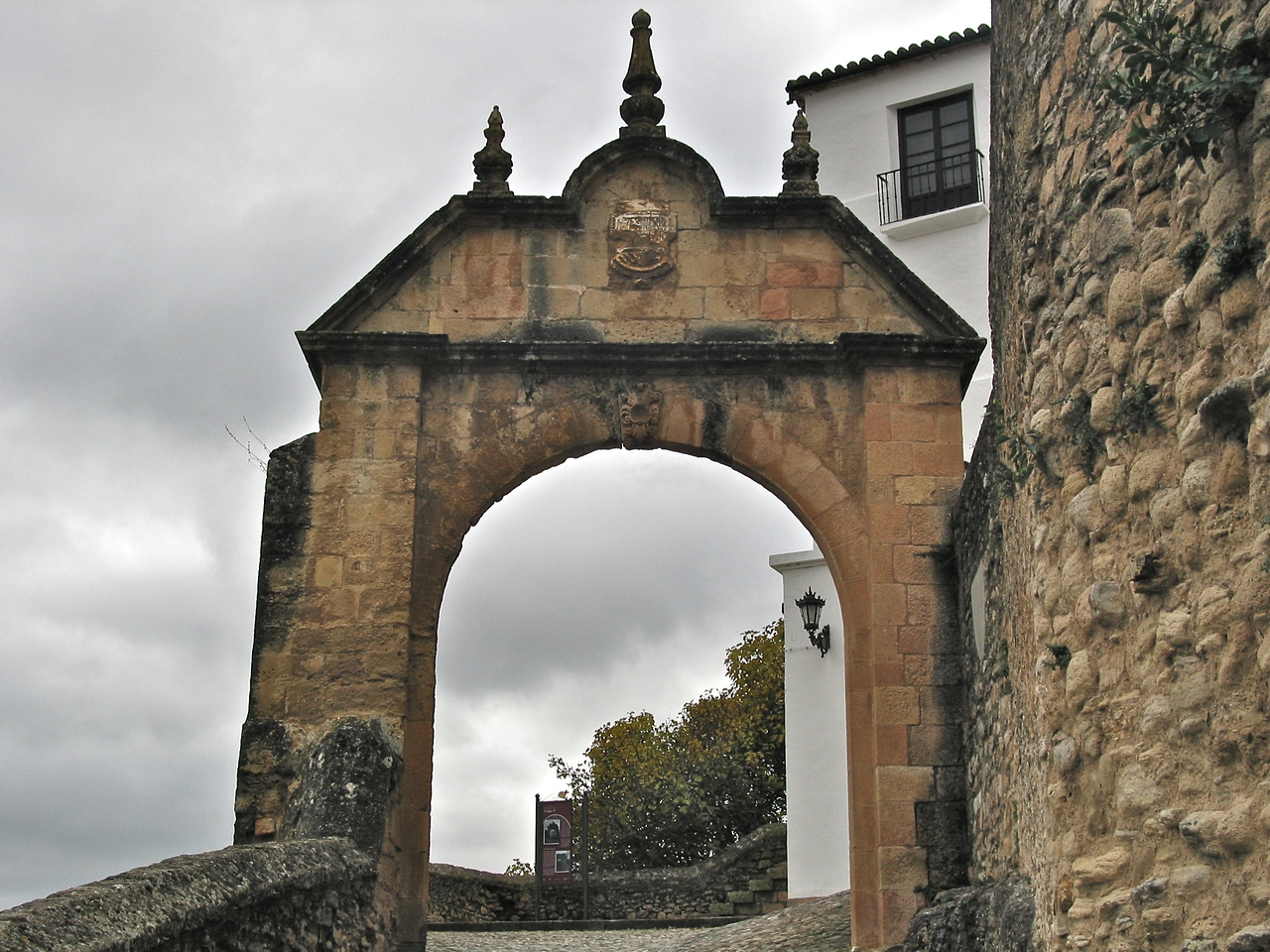 This is one of the old city gates into Ronda, surrounded by an old city wall.