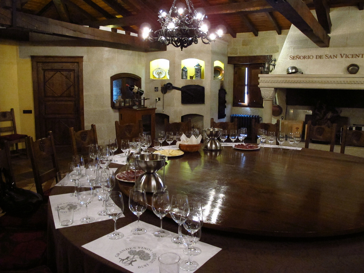 "The large table in the tasting room has a large ""lazy susan"" in the middle."