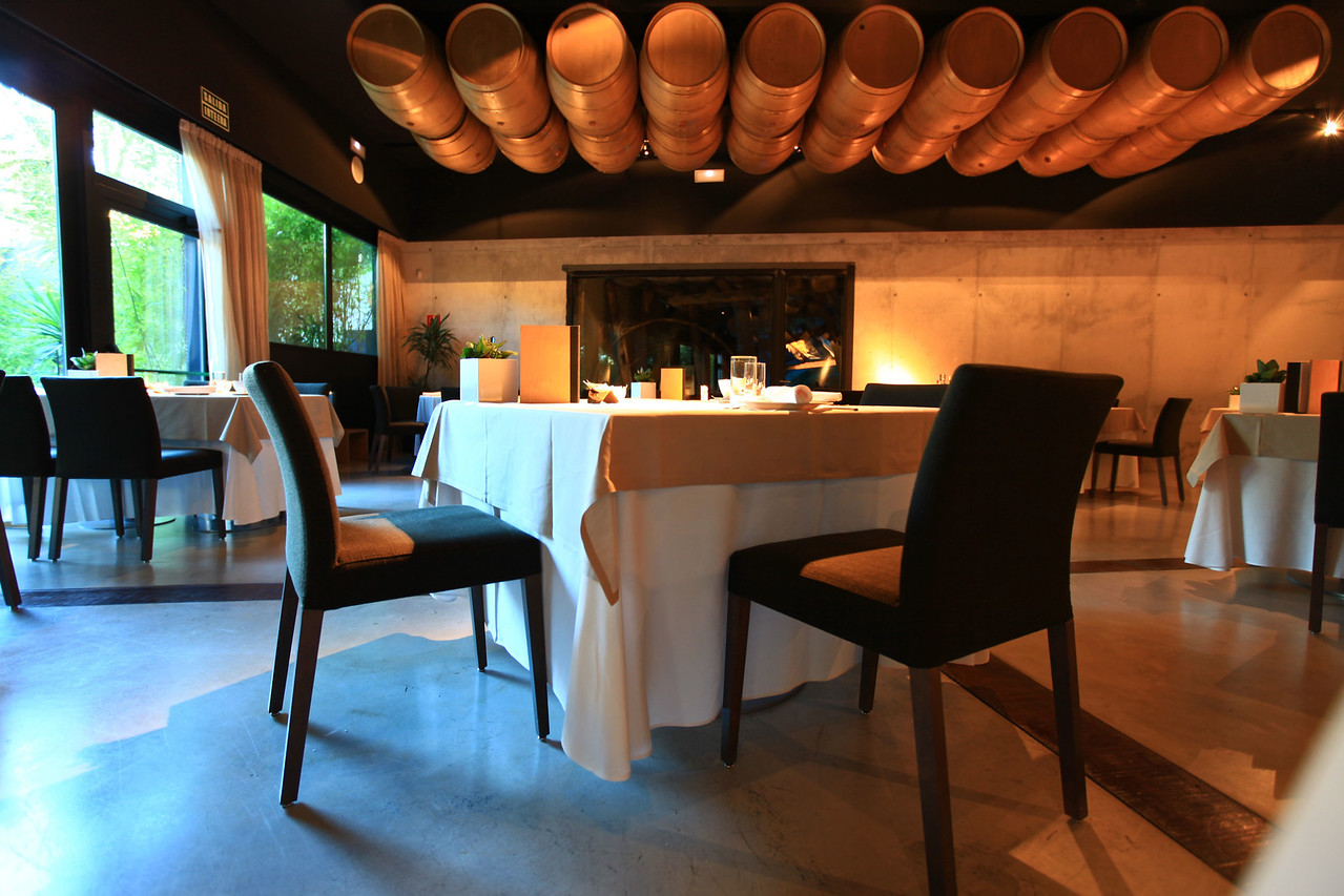 The restaurant has a large wine cellar as well as wine barrels suspended from the ceiling.