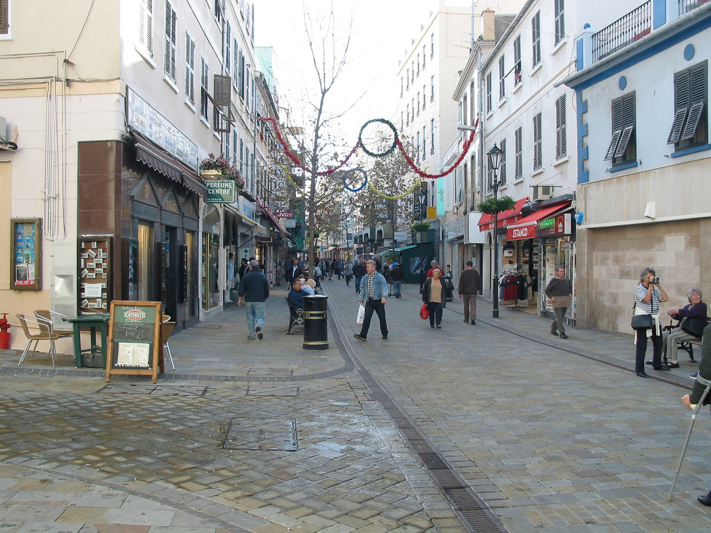 One of the main shopping streets in Gibraltar.  Gibraltar uses it's own version of the pound, but also accepts the British Pound as currency.