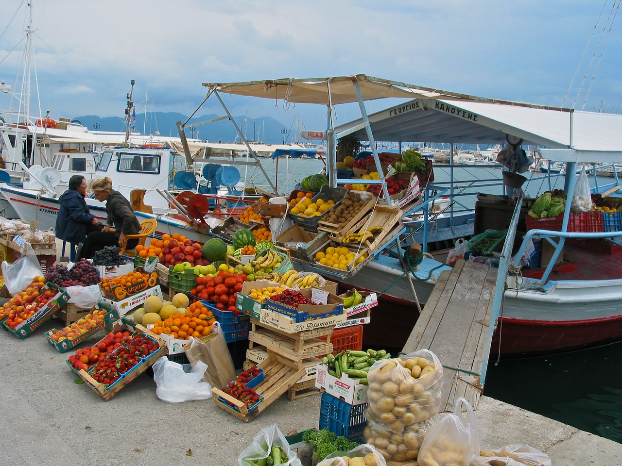 Along the seaside, many boats sell fresh fruits and veggies throughout the day.
