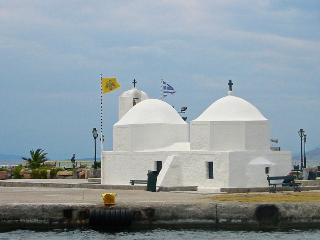 The church of Agios Nikolaos stands in the port of Aegina Town. It is a large church with round dome and it is considered the protector saint of sailors.