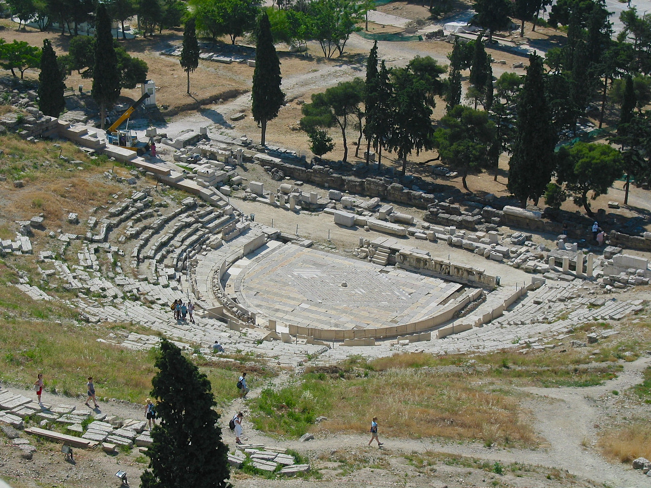 The site of the Theater of Dionysus Eleuthereus, on the south slope of the Athenian Acropolis, has been known since the 18th century. The Greek Archaeological Society excavated the remains of the theater beginning in 1838 and throughout most of the following century. Early remains in the area relating to the cult of Dionysus Eleuthereus have been dated to the sixth century BCE, during the rule of Peisistratus and his successors, but a theater was apparently not built on the site until the fifth century BCE. The only certain evidence of this early theater consists of a few stone blocks that were reused in the fourth century BCE.