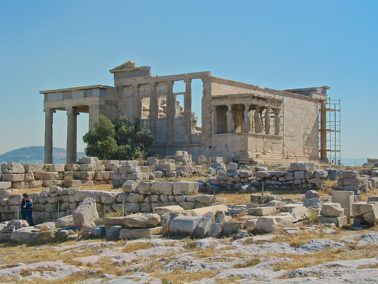 The Erechtheion is an ancient Greek temple on the north side of the Acropolis of Athens in Greece.<br /> <br /> The temple as seen today was built between 421 and 406 BC. Its architect may have been Mnesicles, and it derived its name from a shrine dedicated to the legendary Greek hero Erichthonius. The sculptor and mason of the structure was Phidias, who was employed by Pericles to build both the Erechtheum and the Parthenon. Some have suggested that it may have been built in honor of the legendary king Erechtheus, who is said to have been buried nearby. Erechtheus was mentioned in Homer's Iliad as a great king and ruler of Athens during the Archaic Period, and Erechtheus and the hero Erichthonius were often syncretized.