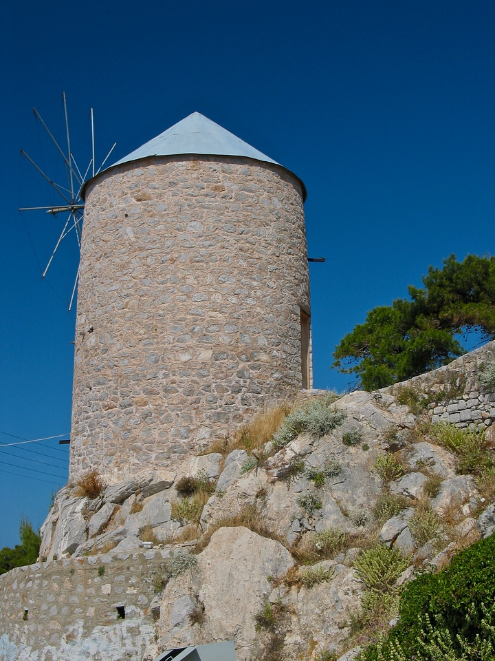 From town, you can walk on a pebble path and you'll see many traditional greek windmills.
