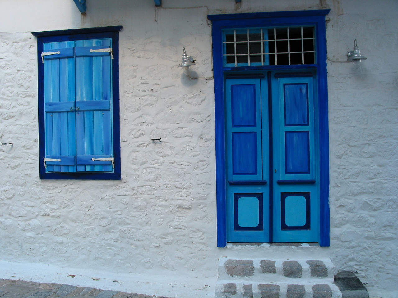 As you walk through town, you also see many of the traditional white washed houses with colorful doors and windows.