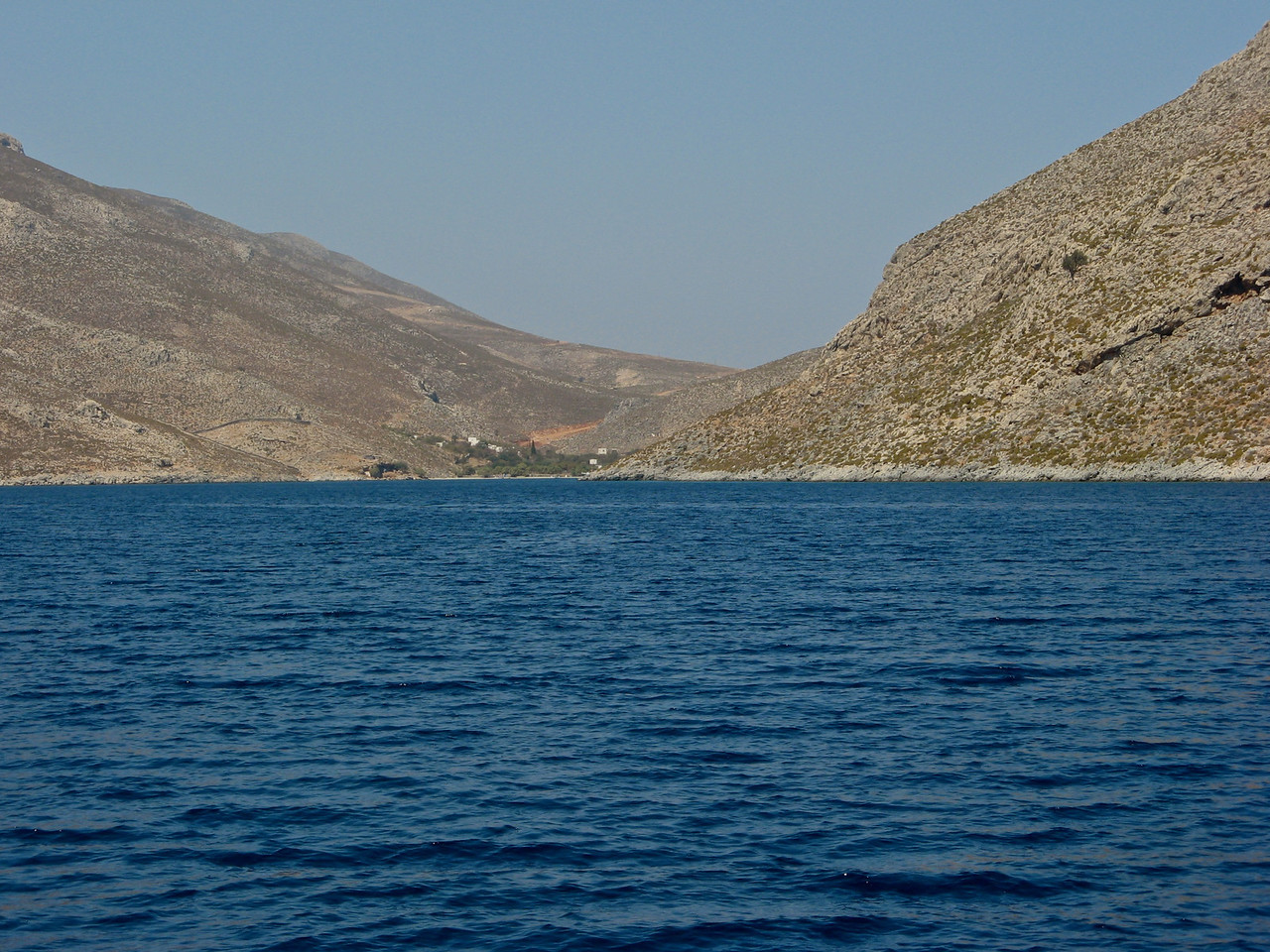 Straight ahead is Kalymnos, our first stop after 3 hours of sailing.  <br /> <br /> Kalymnos,belongs to the Dodecanese and is located to the west of the peninsula of Bodrum (the ancient Halicarnassos), between the islands of Kos (south, at a distance of 12 km) and Leros (north, at a distance of less than 2 km): the latter is linked to it through a series of islets. <br /> <br /> In 2001 the island had a population of 16,235, making it the third most populous island of the Dodecanese,<br /> <br />  It is known in Greece for the affluence of much of its population, and also stands as one of the wealthiest Greek islands overall.