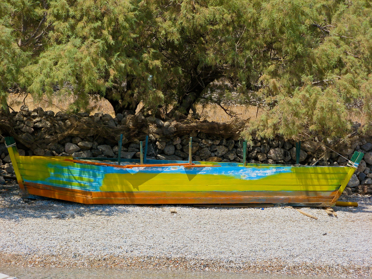 An old abandoned boat on the shore.