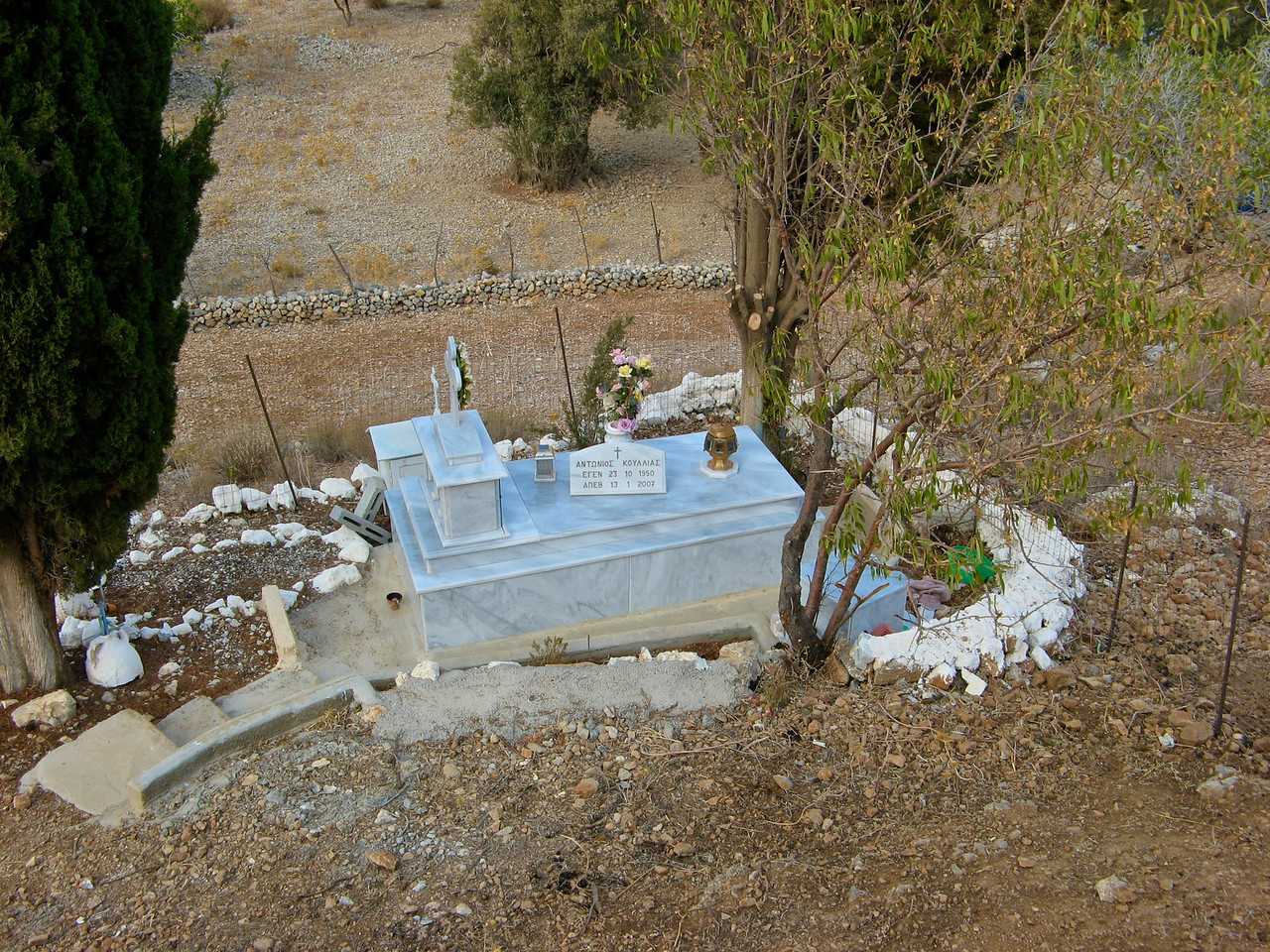Along the way, we pass the gravesite of a former resident.