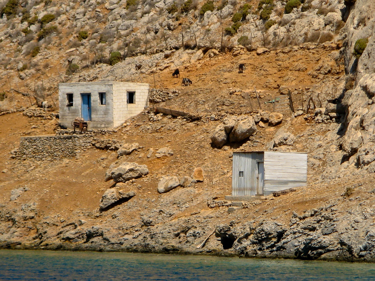 As we pull into the cove, you can see some old houses along the sides.  There are less than 20 people who live here in the cove.