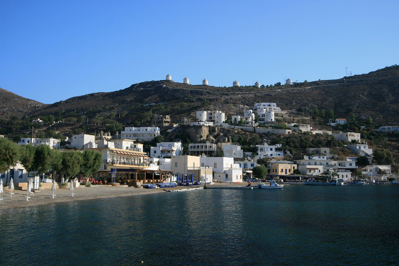 Leros is a Greek island in the Dodecanese. It lies 317 km (171 nautical miles) from Athens's port of Piraeus, from which it can be reached by an 11-hour ferry ride (or by a 45-minute flight from Athens). <br /> <br /> You can see the windmills on the top of the island and the city of Panteli below.