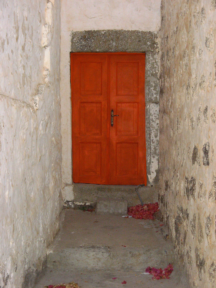 Since most of the houses on Greek Islands are white washed, most doors are painted very bright colors.