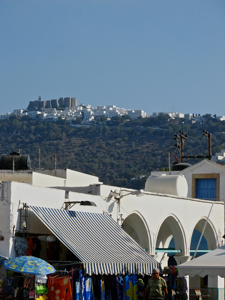A view of Chora, the city on the hill from Skala.