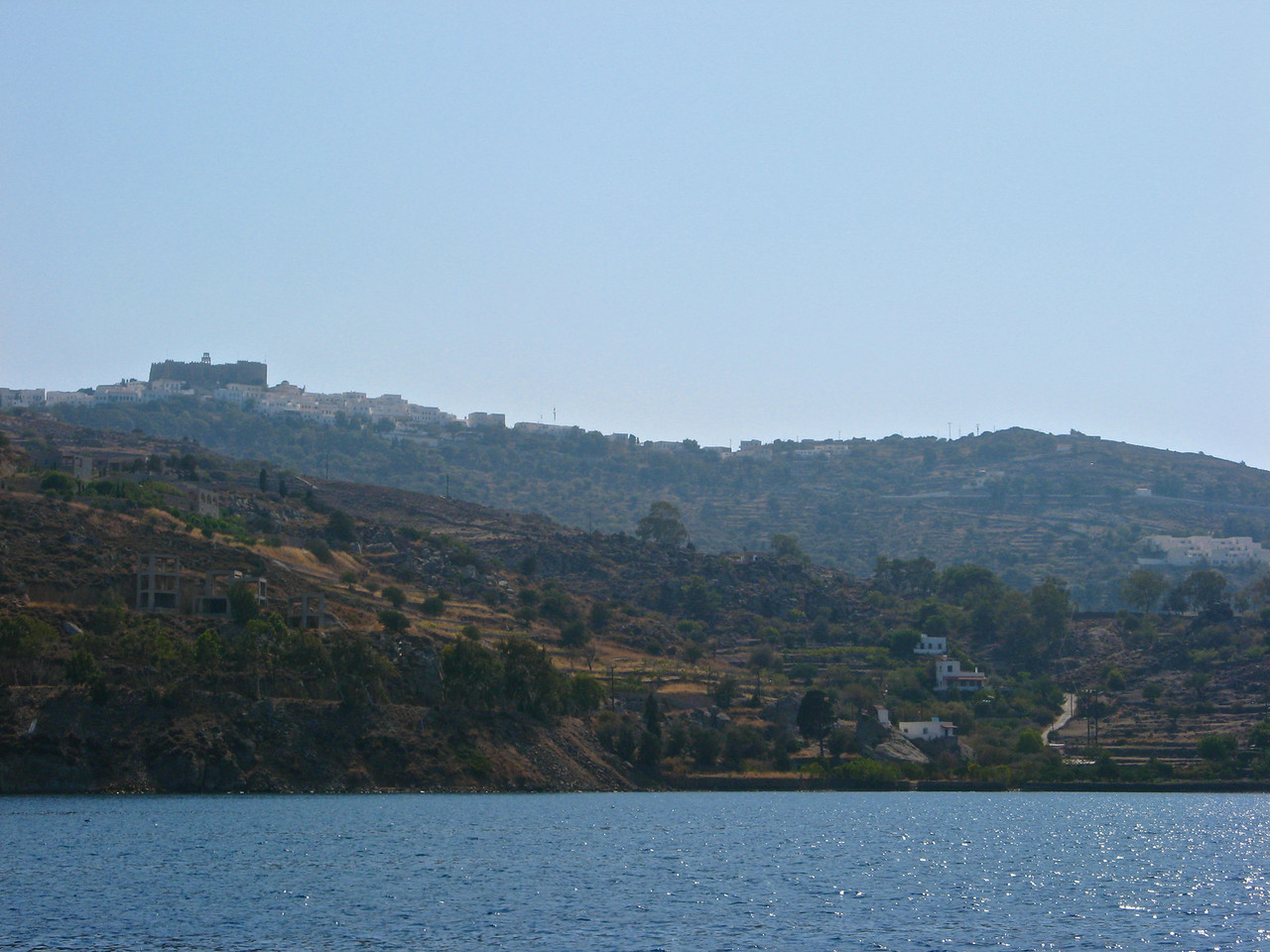 """As we pull into they city of Skala on Patmos, you can see the """"old city"""" Hora at the top of the hill."""