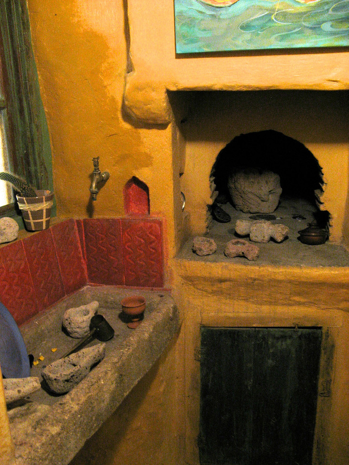 """On our way back to the boat for the evening, we stop in a small store that still has an original kitchen.. you can see the stone sink and the """"built in"""" oven."""