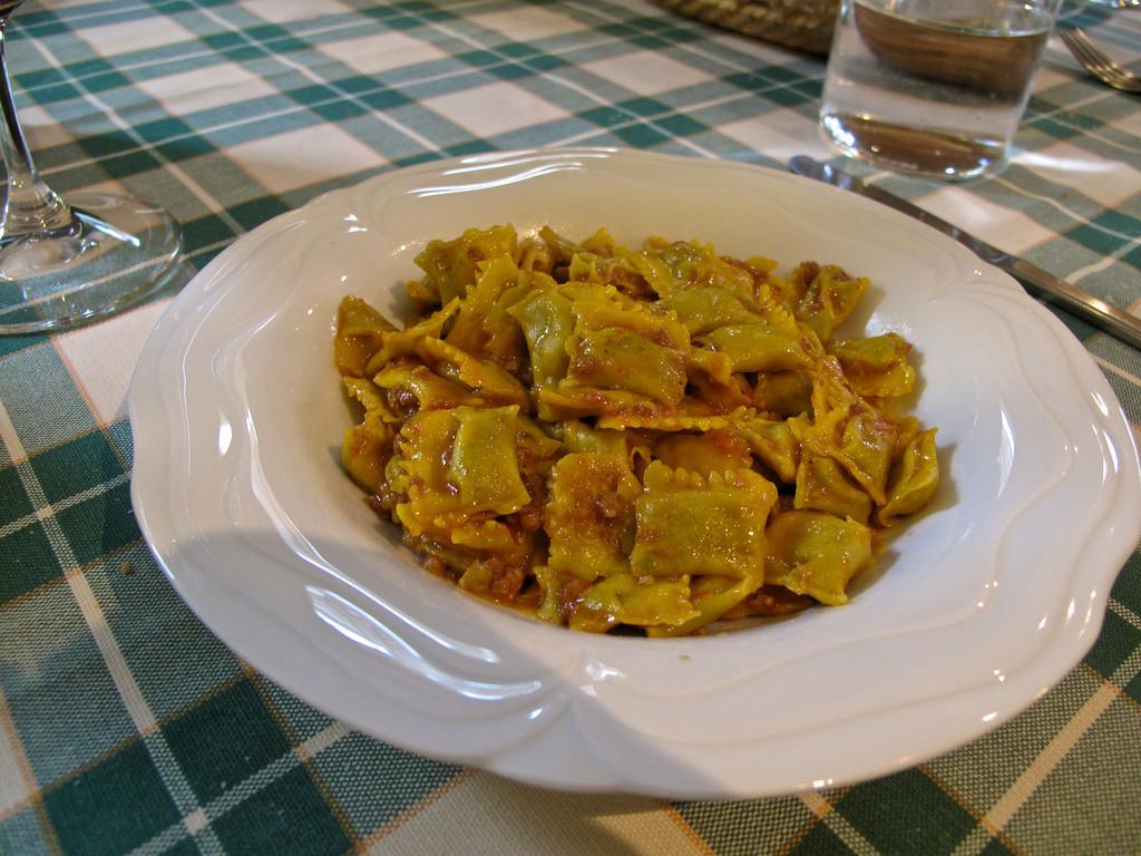 Ravioli with beef ragu sauce.