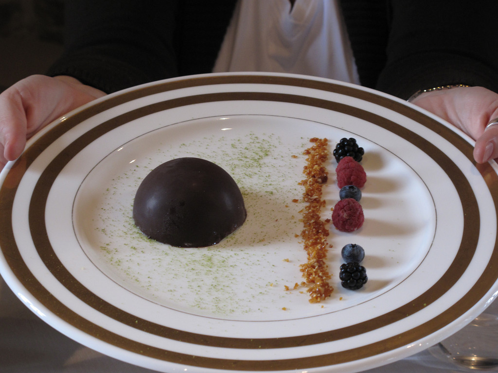 Here's a chocolate shell with pistachio cream inside.