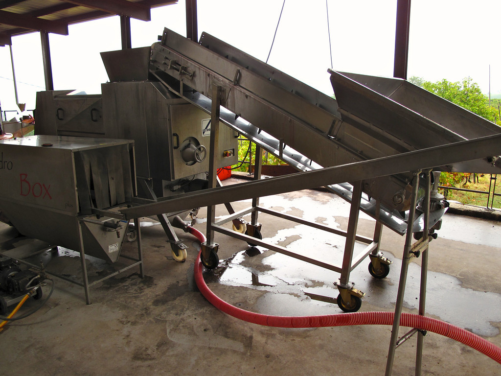 We start with a tour of the facilities.  Once the grapes are harvested, they start by going through the de-stemming machine.