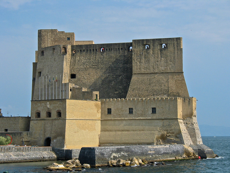 Castel dell'Ovo (in Italian, Egg Castle) is a seaside castle located on the former island of Megaride, now a peninsula, on the gulf of Naples in Italy. The castle's name comes from a legend about the Roman poet Virgil, who had a reputation in medieval times as a great sorcerer. In the legend, Virgil put a magical egg into the foundations to support the fortifications. <br /> <br /> The Castel dell'Ovo is the oldest standing fortification in Naples.  Its location affords it an excellent view of the Naples waterfront and the surrounding area.