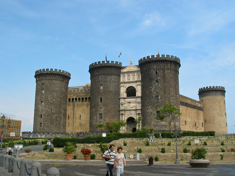 """Castel Nuovo (Italian: """"New Castle""""), often called Maschio Angioino, is a medieval castle in the city of Naples, southern Italy. It is the main symbol of the architecture of the city, and has been expanded or renovated several times since it was first begun in 1279.<br /> <br /> The imposing single-sided white marble triumphal arch, built in 1470, commemorates Alfonso of Aragon's entry to Naples in 1443. It stands between two western Towers of the Angevin castle."""