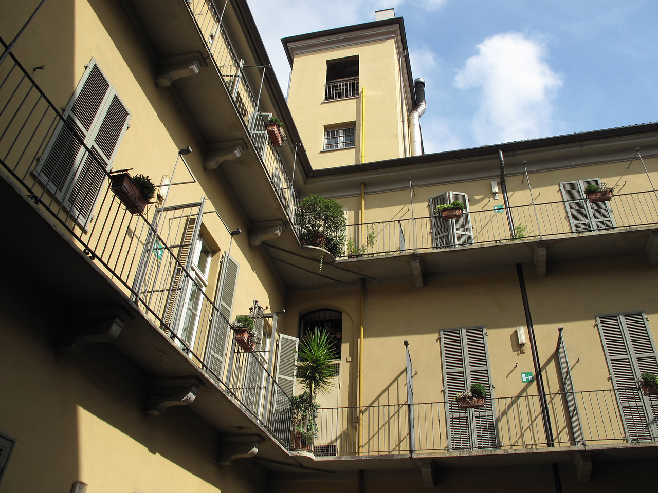 The hotel is located on a quiet street with a large interior courtyard.