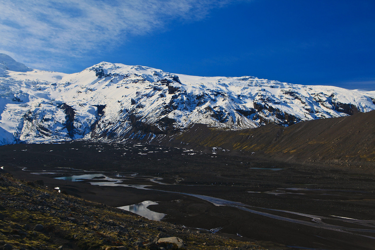 """Mýrdalsjökull is Icelandic for """"(the) mire dale glacier"""" or """"(the) mire valley glacier"""") with a smaller glacier to the west,  Eyjafjallajökull."""
