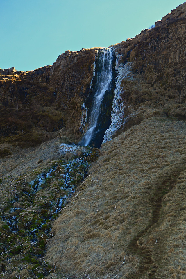 There is a smaller waterfall just to the left.