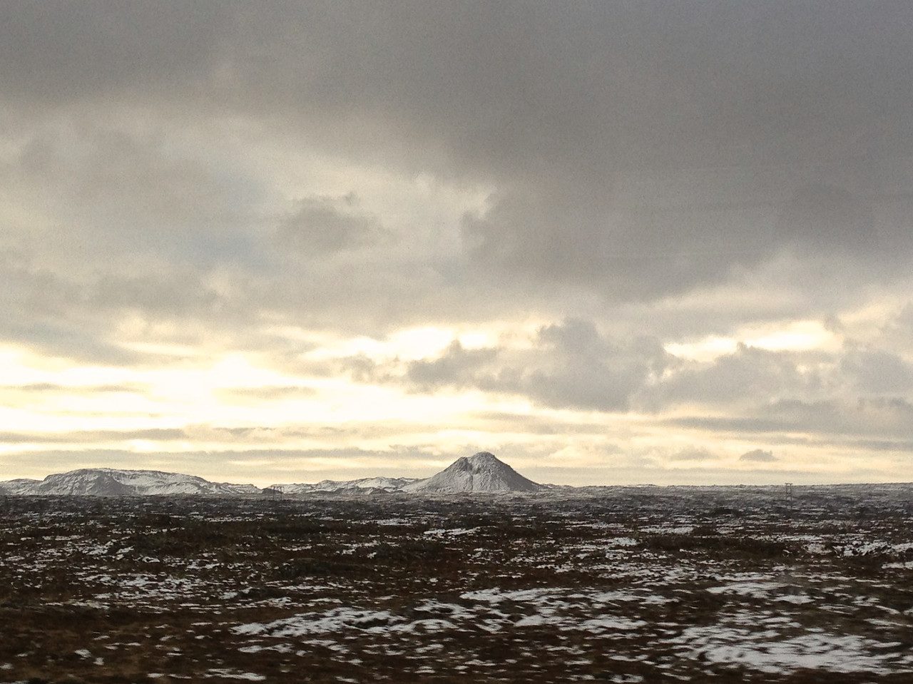 During the trip into Reykjavik, the landscape has a very volcanic look.
