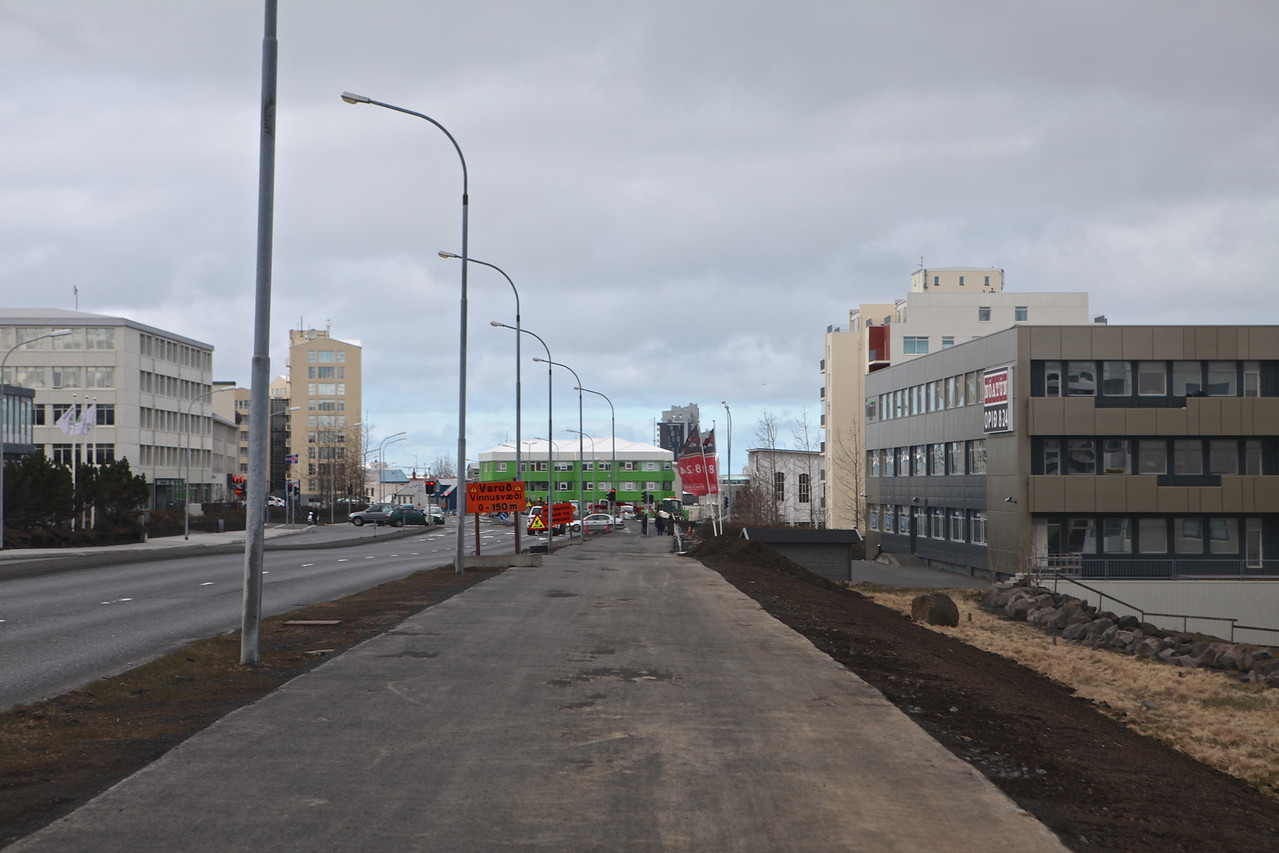 Walkways on either side of the street are large and serve as both pedestrian and bike paths.