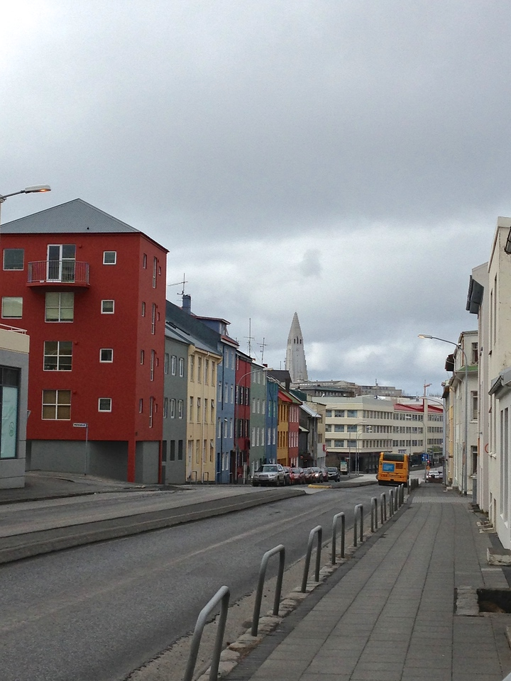 As you walk towards the downtown area, you'll see many colorful houses including the Hallgrímskirkja (Lutheran Church) on the hill.