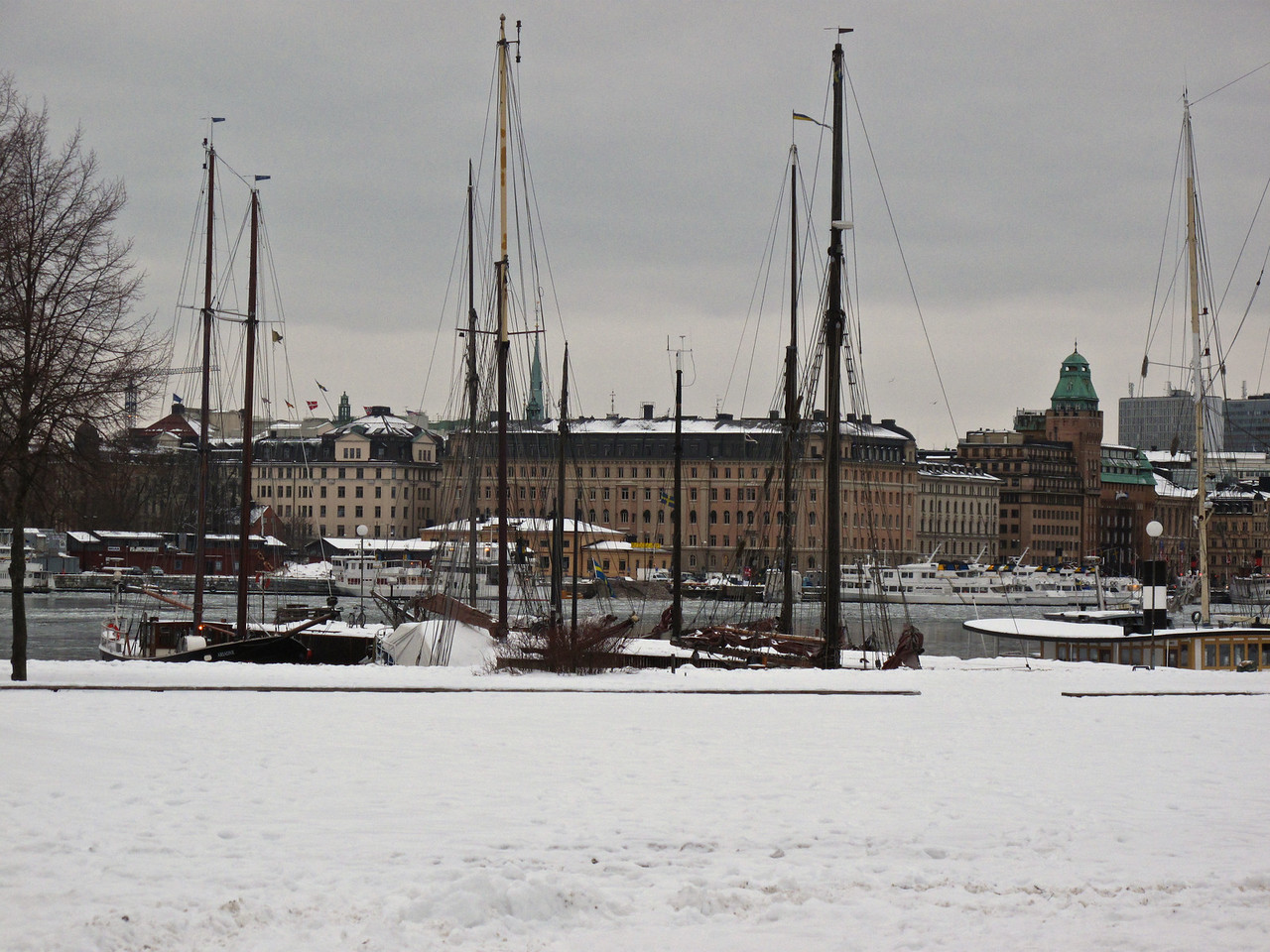 These boats sit along the Strandvagen in Stockholm  Here boats used to bring firewood from the other islands in the city.  When the practice stopped in the 1950s, many people started buying up the boats.  Two associations were formed to preserve the ideology of the place and the boats.