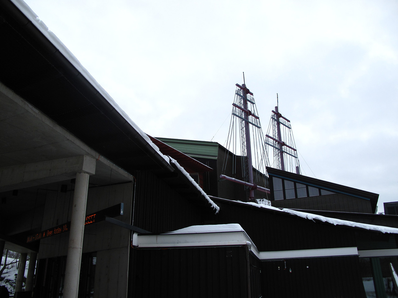 On the exterior, you can see how they built the building around the masts which are of original height and protrude through the roof.