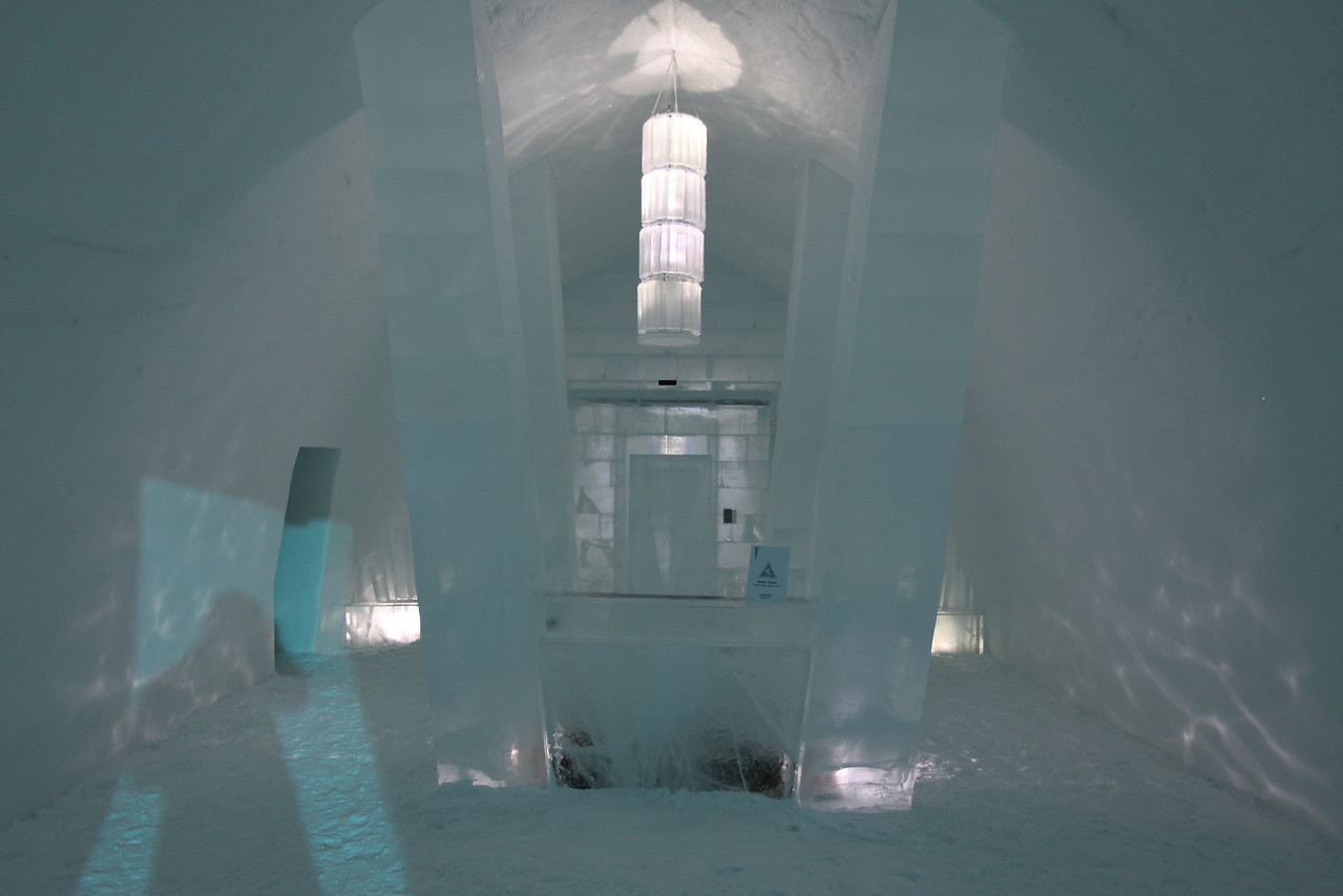 "Icehotel ""lobby"".  The Icebar is off to the left, while the doors in the center is where the main hall and rooms are accessed.  Visitors can access the hotel and rooms from 10AM-6PM each day.  After that, only overnight guests in cold rooms are allowed."