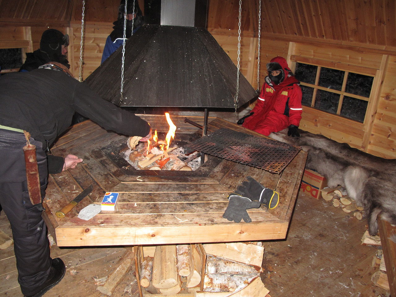Inside the shed we started a fire in the fire pit and sat on reindeer skins to stay warm.  The temperature outside was in the single digits.
